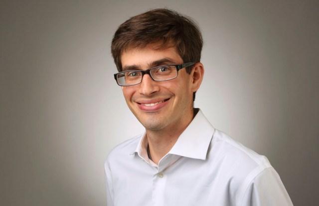 Headshot of Sam Guzik