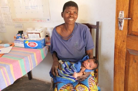 orphan baby with smiling grandma after receiving milk