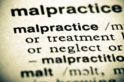 "Image of a dictionary definition of malpractice, with the word malpractice showing, while all other words are blurred except ""treatment"" and ""neglect""."
