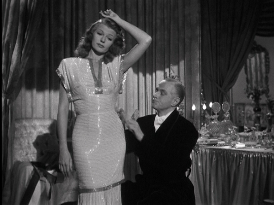 21 Reasons Why You Should Wear the Fashion of the 1940s rita hayworth wearing sequins in the 1940s