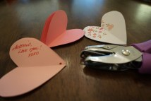 Stack your 4 hearts, write a message or name and hole punch.