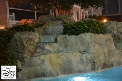 Water falls into the lazy river at Yacht Club stormalong bay.