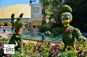 The 2017 Epcot International Flower and Garden Festival - Pluto and Donald outside of the Festival Center