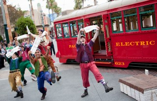 "'RED CAR NEWS BOYS' -- Part of the new lineup of entertainment on Buena Vista Street at Disney California Adventure park in Anaheim, Calif., the ""Red Car News Boys"" roll into town on the Red Car Trolley bringing the latest headlines and belting out songs from the '20s and '30s. It's all part of the fun of the high-energy show. (Paul Hiffmeyer/Photographer)"