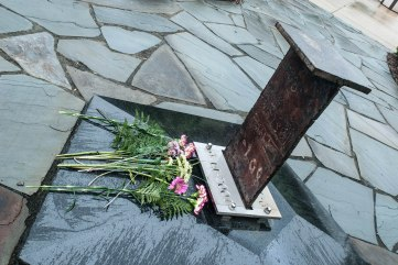Flowers were placed on a memorial constructed from a beam belonging to one of the original World Trade Center towers, which stands in the Memorial Garden in front of Stow City Hall.