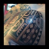 Upclose of freehand tattoo. Putting the black in proper