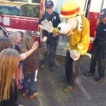 San Andreas Fire Protection District volunteers teach safety to kindergarteners at the Mark Twain Medical Center Teddy Bear Picnic.