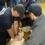 Volunteer firefighters training in CPR.