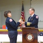 San Andreas Fire Protection District Chief Don Young, left, presents the Firefighter of the Year Award to Capt. Susan Young during an awards dinner on Saturday in the San Andreas Town Hall.
