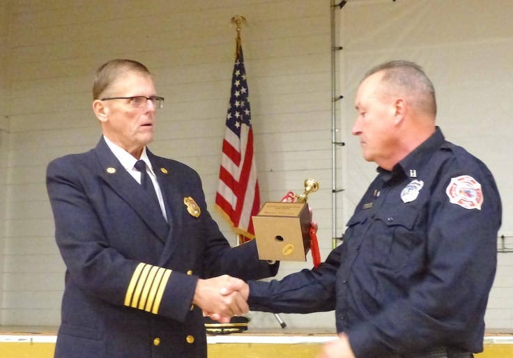 San Andreas Fire Protection District Chief Don Young, left, presents the Firefighter of the Year Award to Capt. Brian Santos during an awards dinner on Saturday in the San Andreas Town Hall.