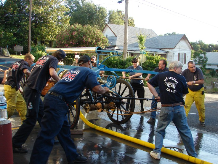 Firefighters use Blue Boy to pump water in front of Station No. 1 on Church Hill Road.