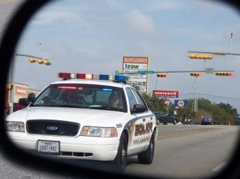 Charlie KC5NKK riding in UC PD Patrol Car