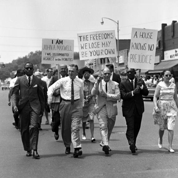Michigan Gov. George Romney marches toward a progressive future.
