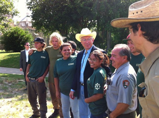 Interior Secretary Ken Salazar with E-Corps volunteers and San Antonio Missions National Historic Park staffers sat Mission Concepción.