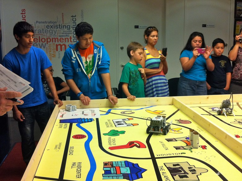 A team of Dwight Middle School students watches as the robot they built and programmed rescues San Antonio