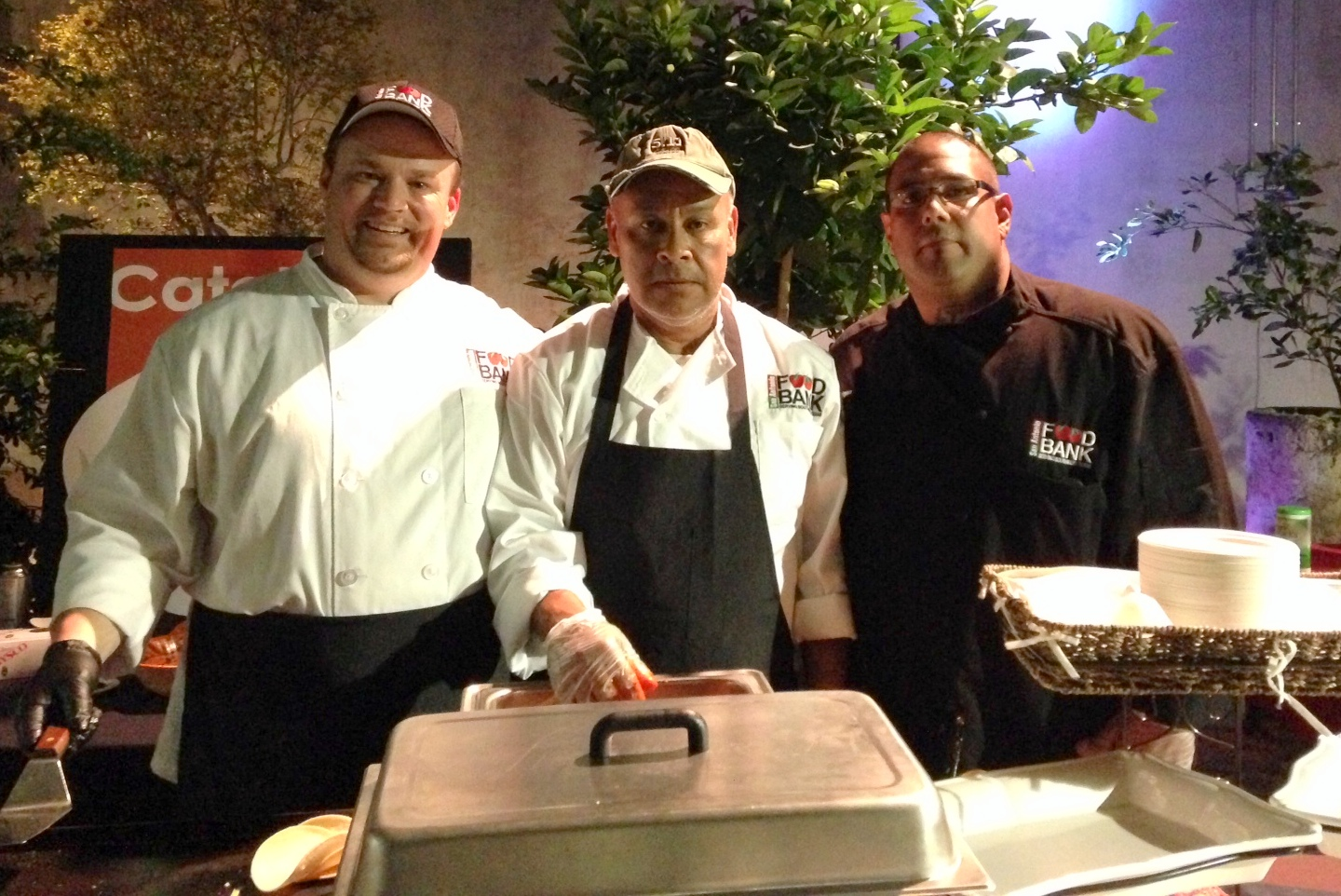 From left: Students Robert Gratteau and Rudy Fernandez with Staff Chef David Rodriguez, proudly representing the San Antonio Food Bank, Community Kitchen, and Catalyst Catering programs.