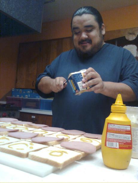 Sammy Rodriguez makes sandwiches for Inner City Development