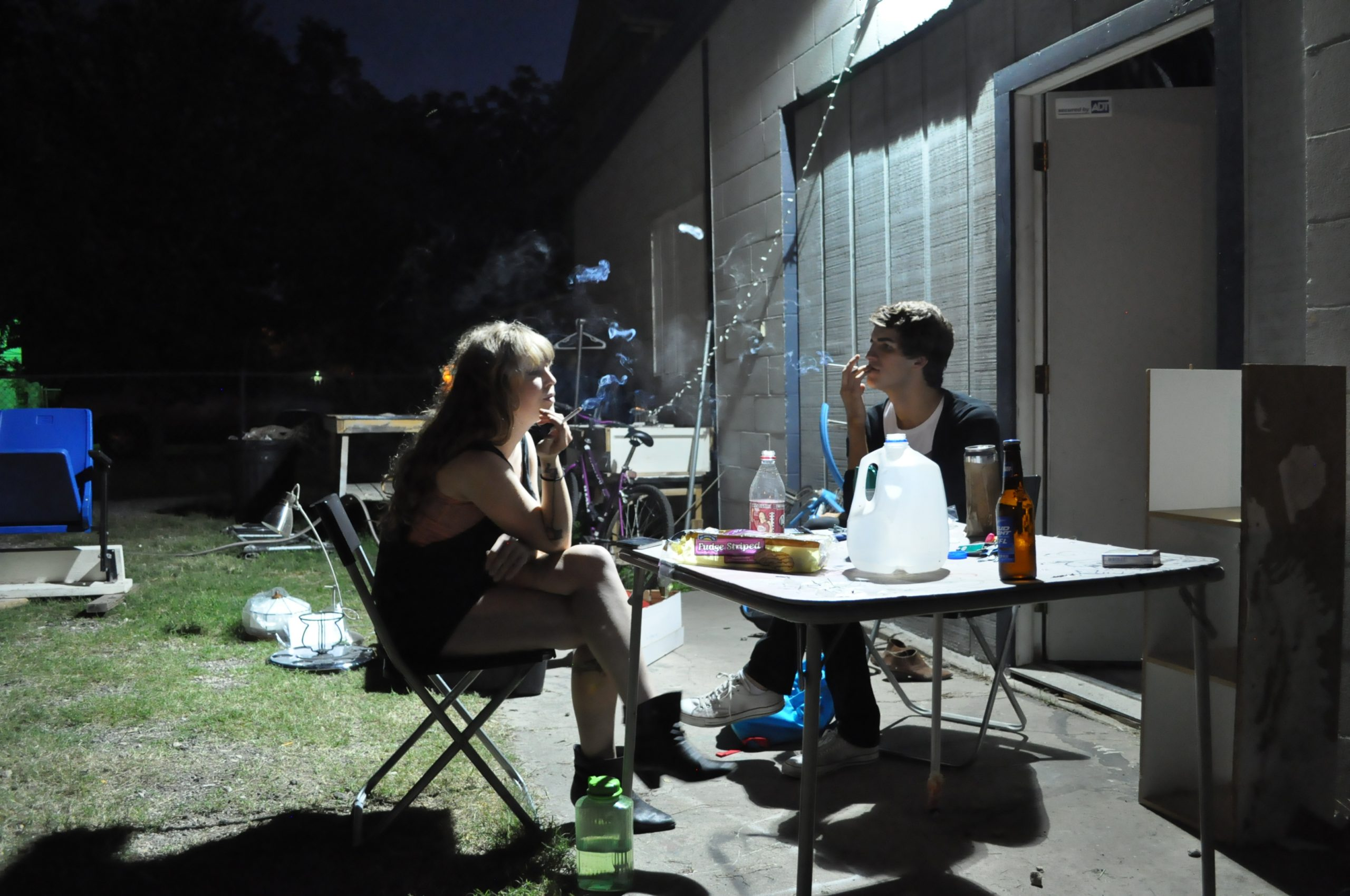 Actors discussing a scene during a smoke break. Photo by Jacob Coltrane Burris.