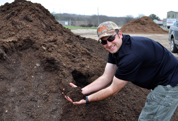 From organic trash to gold for your garden in just 4-6 months.  John Kalmbach shows off COSA compost.  --Photo by Iris Dimmick