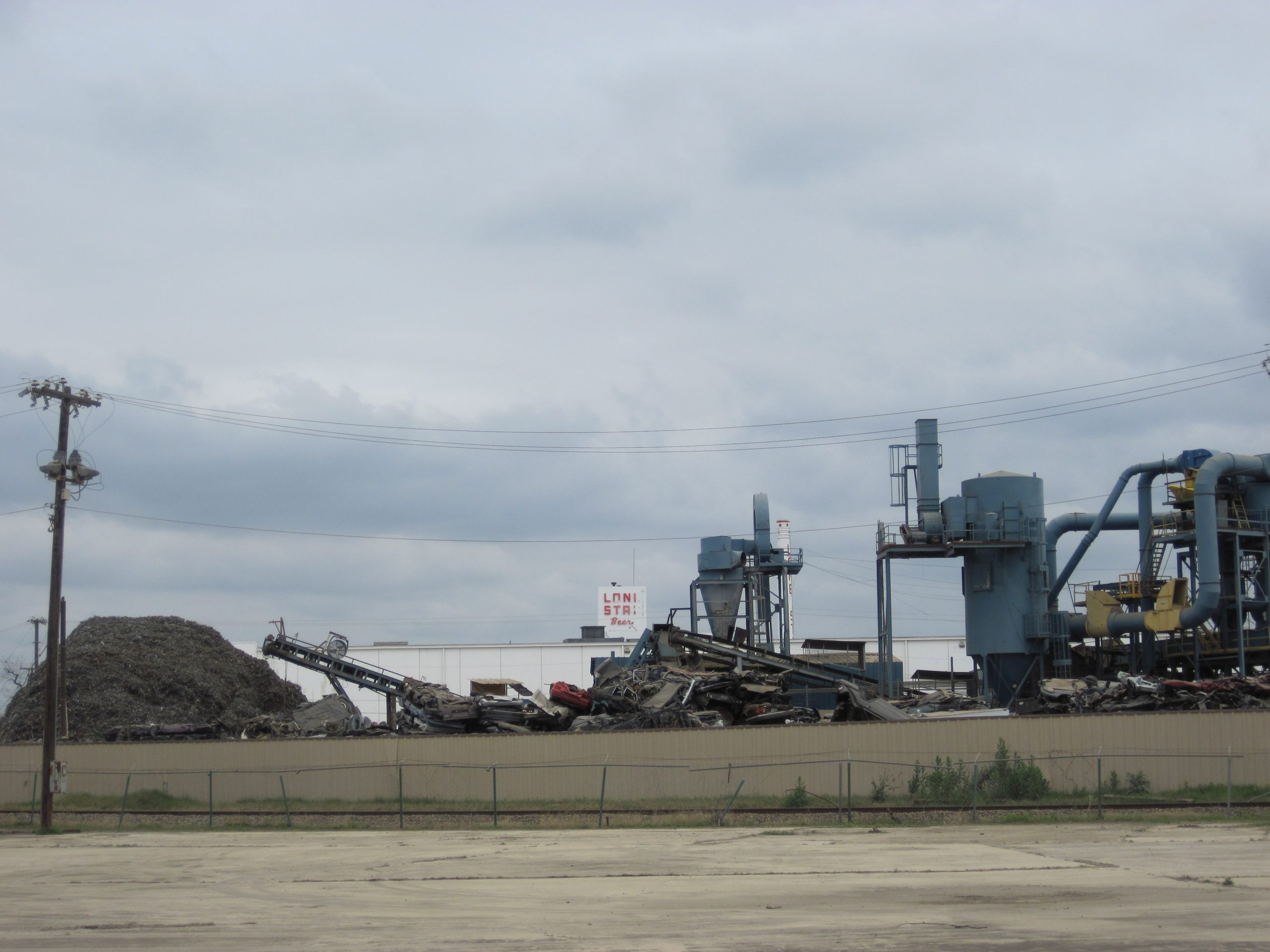 The Newell Plant, where cars go to die in the shadow of the abandoned Lone Star brewery. Photo by Randi Rushing.