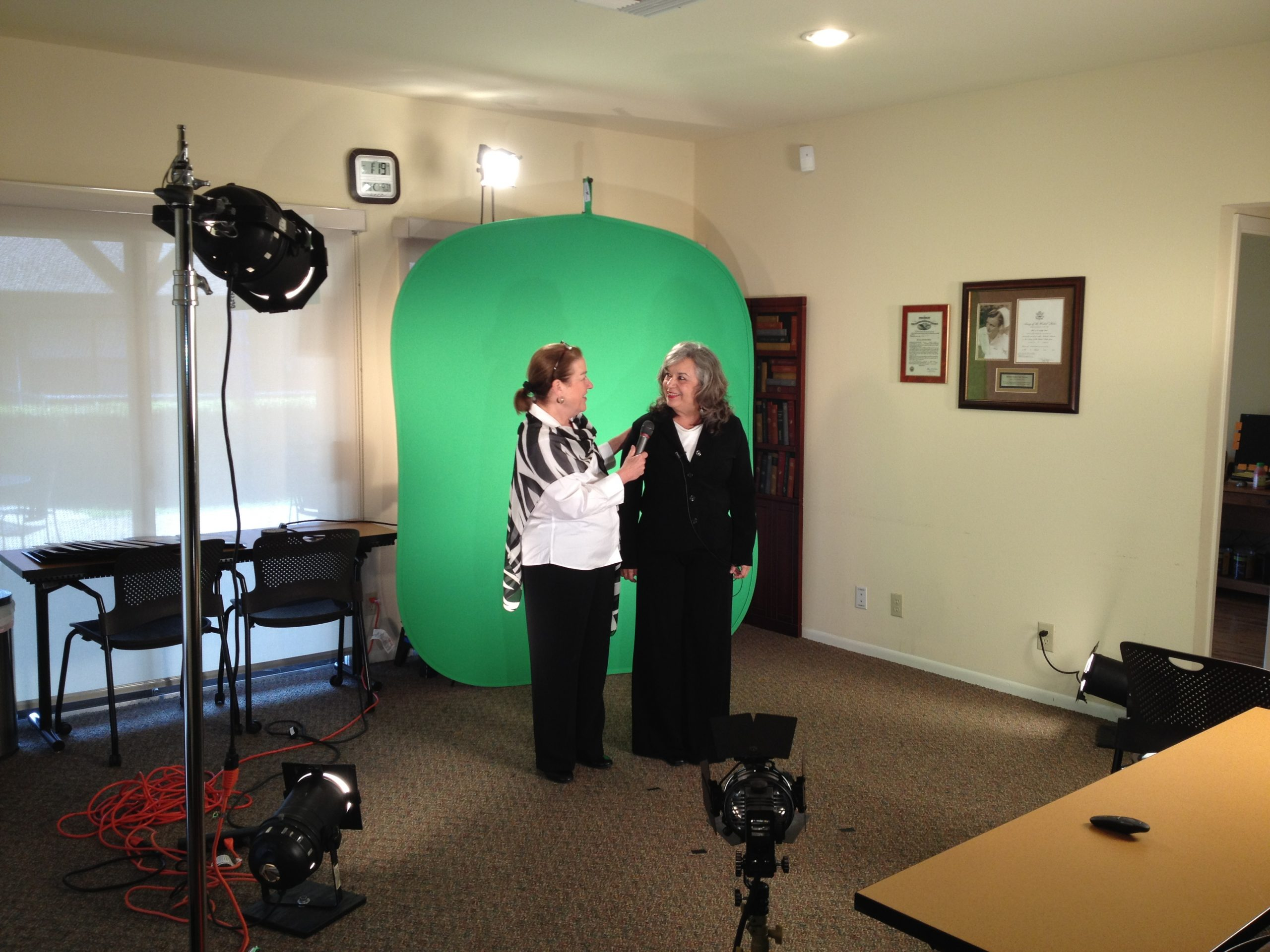 Video recording using green screen technology – Maria Wellisch, VP of Corporate Training at Morningside & Virginia Valenzuela
