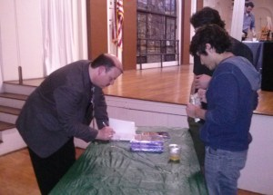 After the discussion, Travis poling signed copies of his new book. It is available locally in the Twig Book Shop.