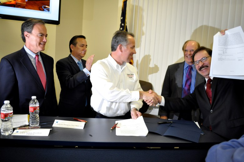 The celebratory handshake between Toyota Manufacturing and Alamo Colleges at the official announcement of the Toyota/Alamo College Advanced Manufacturing Technician Program. From Left: House Speaker Joe Straus, Sen. Carlos Uresti, Chris Nielsen; TMMTX president, Bexar County Judge Nelson Wolff and Dr. Frederico Zaragoza; vice chancellor of Economic and Workforce Development at the Alamo Colleges.
