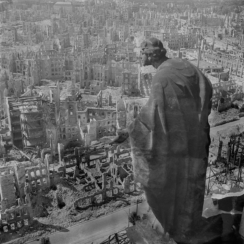 Dresden, 1945, view from the city hall (Rathaus) over the destroyed city (the allegory of goodness in the foreground). Photo by Richard Peter (1895–1977) via Wikipedia. (Creative Commons license.)