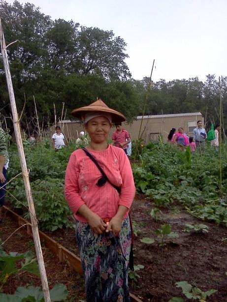 International garden work day: Refugees and volunteers enjoy a work day in the garden. Photo courtesy of International Community Garden.