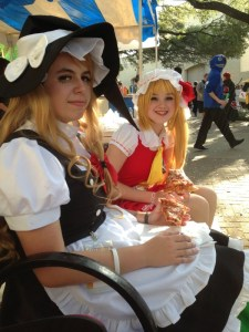 cosplay girls sit on bench anime conference