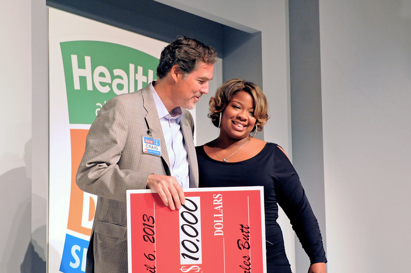 April 6 2013 Brittany Ward, a graduate student in occupational therapy at the University of Texas Health Science Center at San Antonio, won the $10,000 grand prize in the 2013 H-E-B Slim Down Showdown. Pictured with Craig Boyan, H-E-B's president and COO. Photo courtesy of H-E-B.
