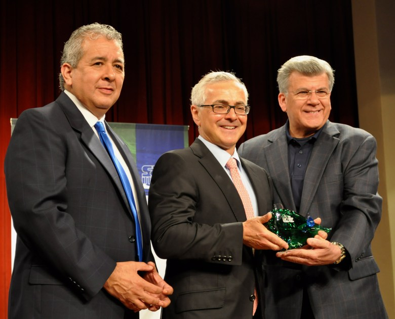 """NuStar Energy CEO Curt Anastasio (center) accepts the 2013 SAWS Refreshing Ideas Award from and SAWS Chairman Heriberto """"Berto"""" Guerra (right) and SAWS President and CEO Robert Puente. Photo by Iris Dimmick."""