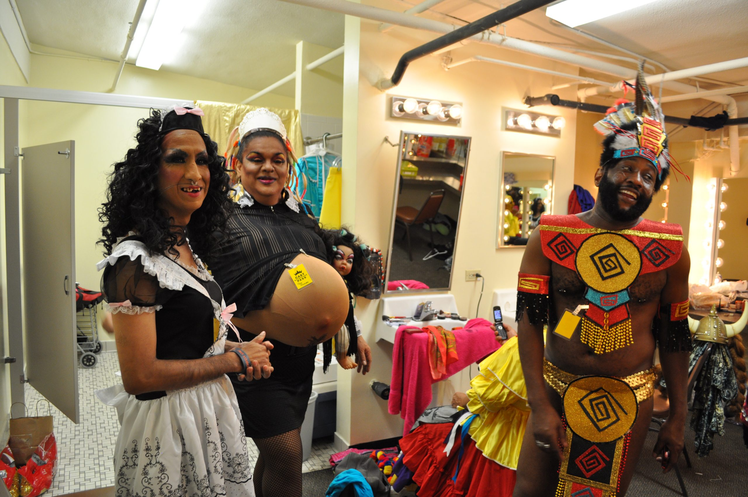 Costumed men relax and chat in dressing rooms before their Cornyation performances on stage at the Empire Theatre. Photo by Iris Dimmick.