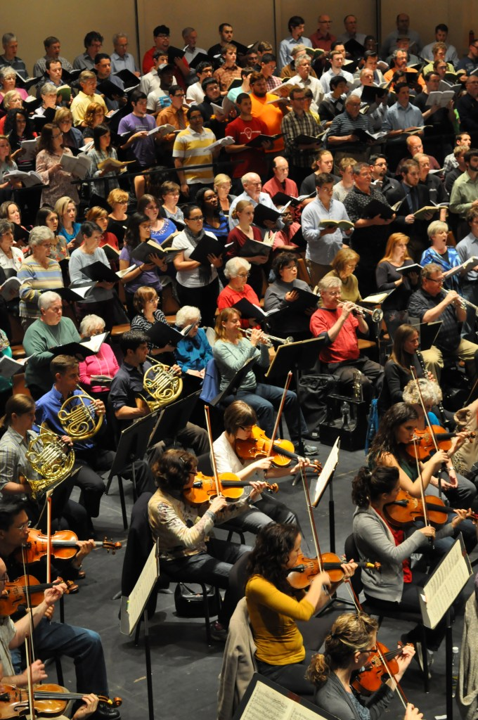 The San Antonio Symphony practices alongside three different choir groups, gathered from communities young and old. Photo by Iris Dimmick.