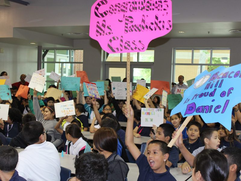 Daniel's Beacon Hill classmates cheer him along at a fundraising event. Photo courtesy of SAISD.
