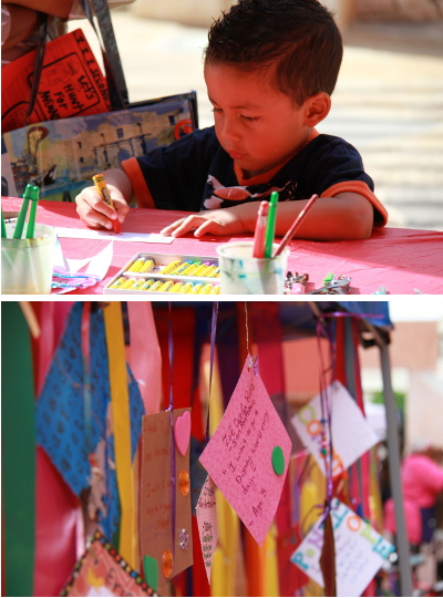 """A child writes down his wish to be sent to President Barack Obama for the """"Milagros Wall"""" at the Texas Book Festival/San Antonio Edition. Photo by Shane Kyle. Amoung the wishes: """"I wish for more peace in the WORLD,"""" """"My wish is to finish High School,"""" and """"I wish for a happy family."""""""