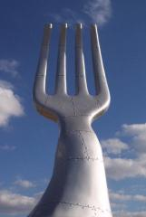Chef Damien Watel, also an artist, provoked an outcry in Stone Oak with his installation of a large Fork sculture. He was forced to cover it with an ugly wall. Photo courtesy of StoneOakInfo.com.
