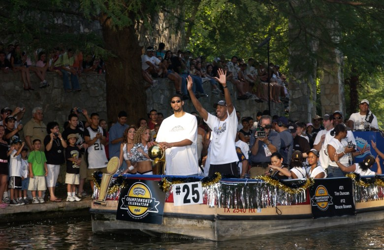 Tim Duncan and David Robinson greet the fans on the San Antonio River after winning the 2003 NBA Championship.