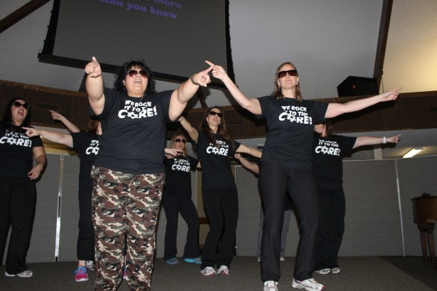 """Brighton Center leadership team performing for the staff at """"All Staff Day,"""" an appreciation event. Photo courtesy of the Brighton Center."""