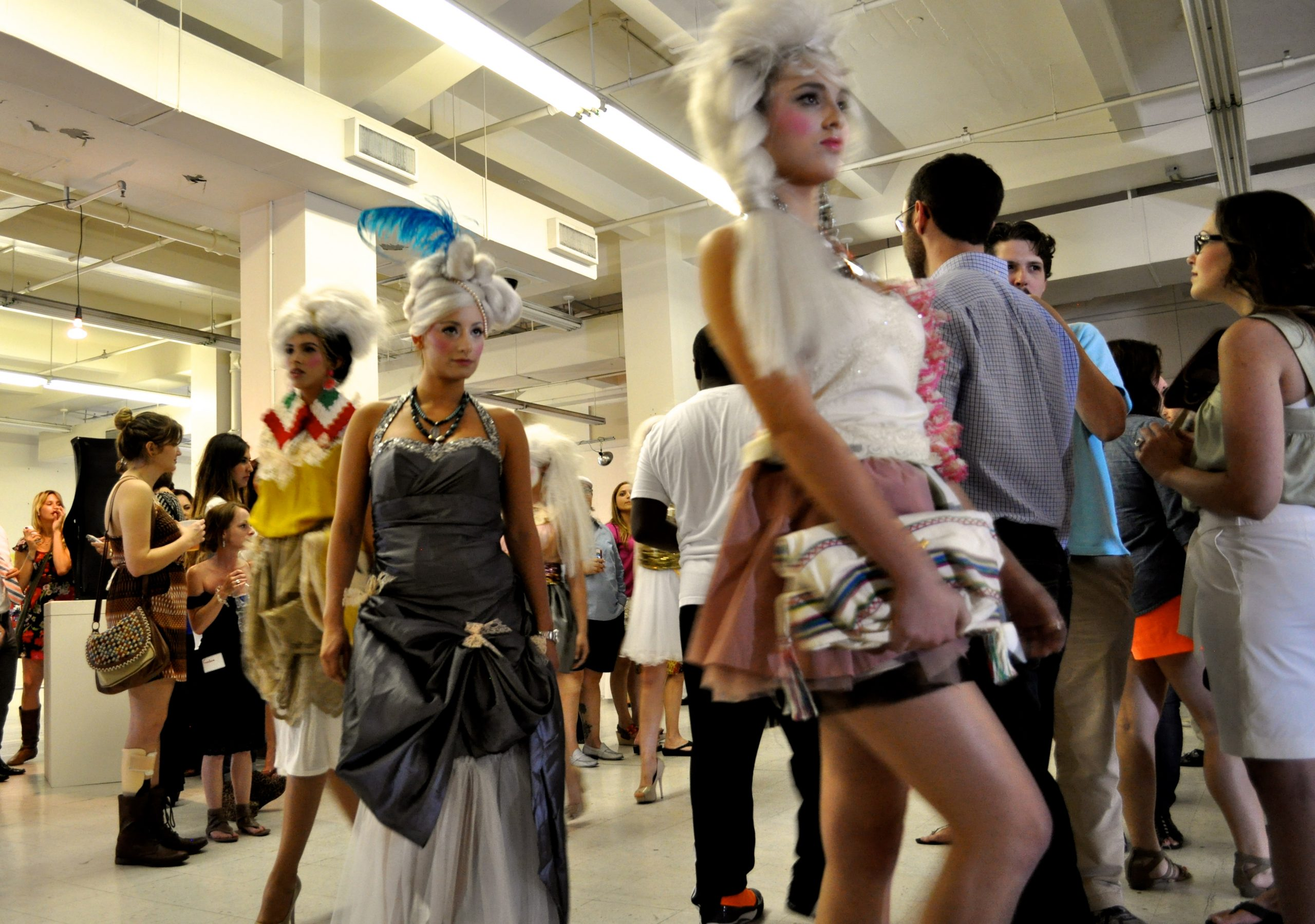 Models wear the work of local designer Agusto Cuellar while they weave through the crowd gathered at the Center City Open House. Photo by Iris Dimmick.
