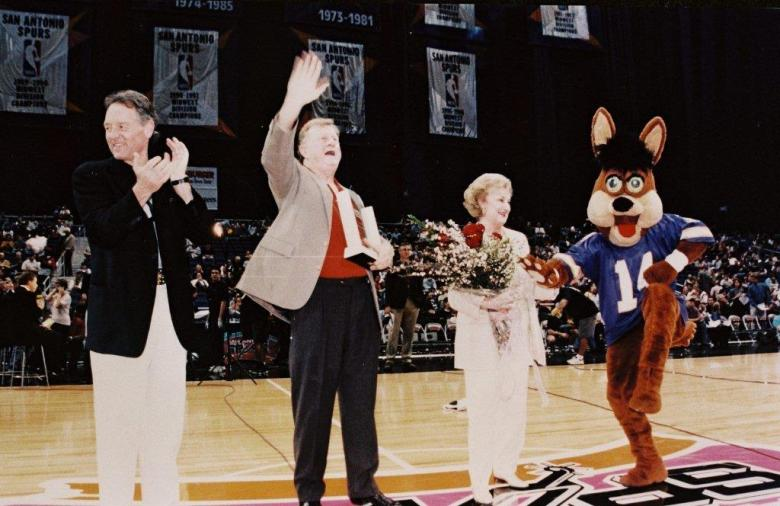 Spurs owner Peter Holt, joined by the Coyote, applauds Red and Charline McCombs. Photo courtesy of Red McCombs