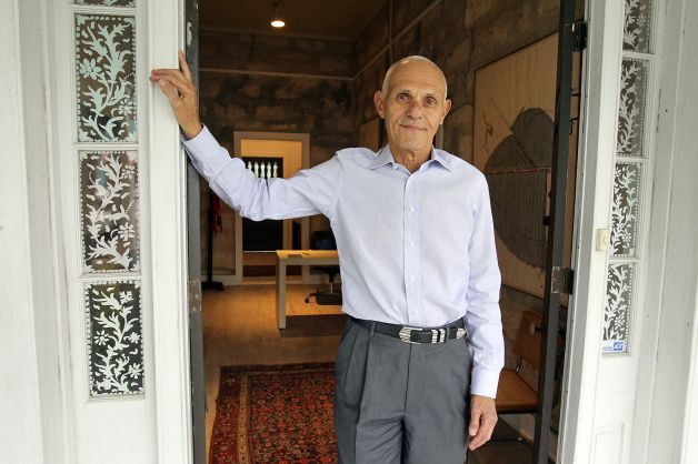 Mel Weingart stands in the doorway of TOSA's offices on 6th street. Photo credit: David Hendricks.