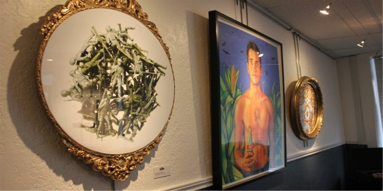 """Arturo Infante Almeida's work """"Toy Soldiers"""" provides a stark contrasting to the adjacent Guerrero painting. Photo by Melanie Robinson."""