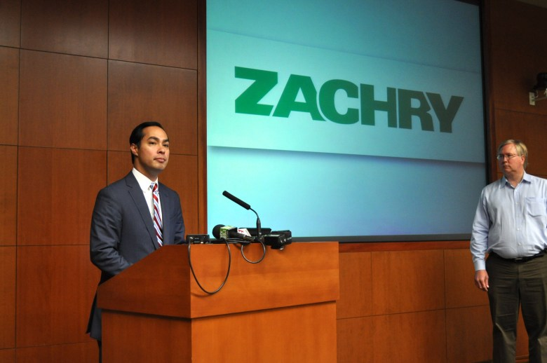 Rackspace Chairman and Co-founder Graham Weston looks on as Mayor Julián Castro (left) address the small crowd gathered at Zachry Holdings Inc. headquarters about the importance of immigration reform to the business community and local industry. Photo by Iris Dimmick.