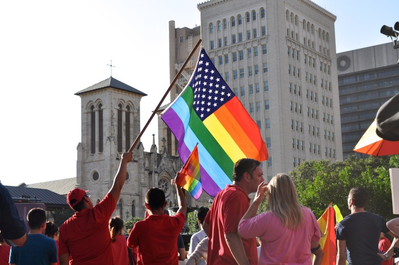 Marriage equality supporters wave LGBT rainbow flags at Main Plaza in celebration of the Supreme Court's decision that found Prop 8/DOMA unconstitutional. Photo by Iris Dimmick.