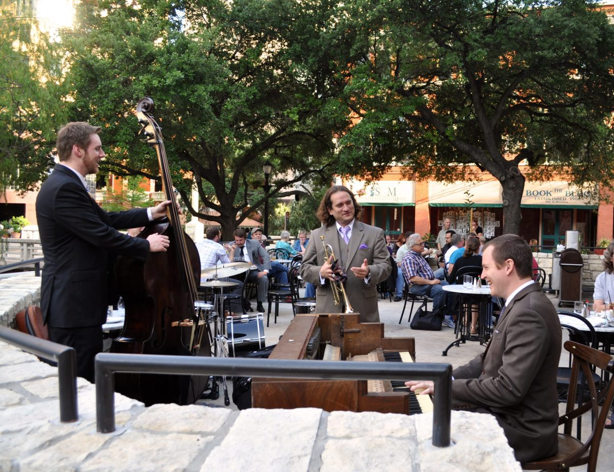 An ensemble of Brent Watkins (right) South Texas Jazz group laughs during a break at a performance during happy hour at Lüke, 125 E. Houston St.
