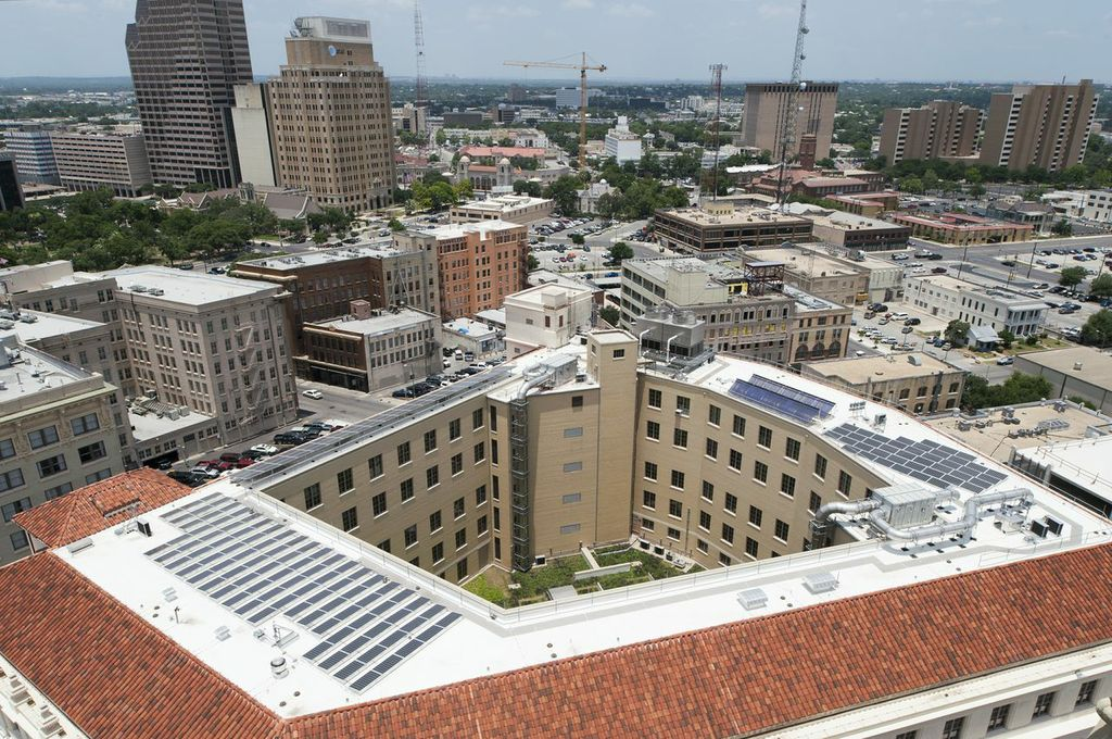 An arial view of the Hipolito F. Garcia Federal Building and U.S. Courthouse. Its LEED renovation projects included a green (landscaped) roof, a 50 KW solar array, and energy efficient AC mechanisms. Photo by Mark Menjivar, courtesy of Ford, Powell & Carson architects.