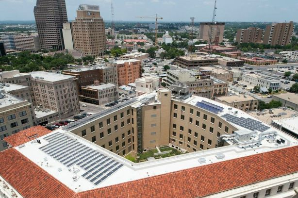 An arial view of the Hipolito F. Garcia Federal Building and U.S. Courthouse. Its LEED Platinum renovation projects included a green (landscaped) roof, a 50 KW solar array, and energy efficient AC mechanisms. Photo by Mark Menjivar, courtesy of Ford, Powell & Carson architects.