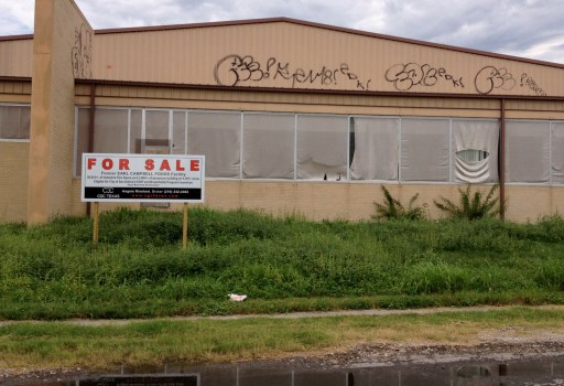 A graffiti-scarred empty factory, once home to Earl Campbell's meat products.