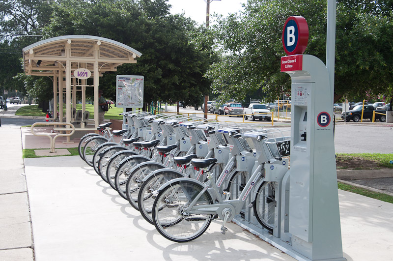 A B-cycle station in San Antonio – curiously placed on the sidewalk instead of along roadways. Leo Suarez.